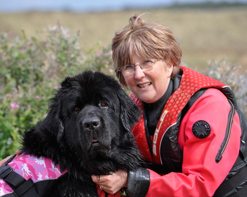 Photograph of Carol Taylor with a black Newfoundand
